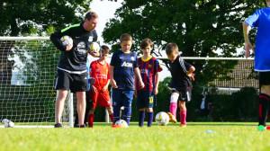 Kid Kicking Ball- Young football players