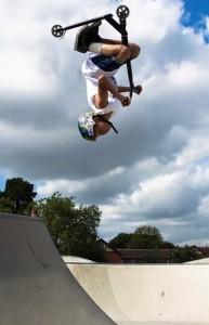 A Scooter's flip on a skate park
